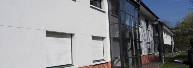 Pose d'un film solaire anti chaleur pour vitre IME Fondation Bellan